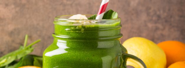 Healthy green smoothie  in glass jar and ingredients on old wood. Detox, diet, healthy, vegetarian food concept with copy space.