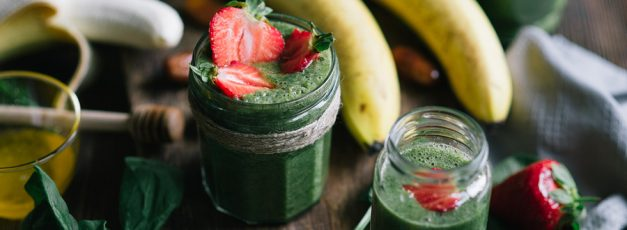 Healthy smoothie made with banana, spinach, dates and honey. A process of cooking.